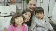 Happy loving family laughing and spending time together at home Stock Footage
