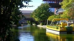 Oklahoma City Bricktown Riverwalk With Tour Boat Stock Footage