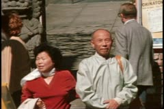 Stock Video Footage of San Francisco, 1970's, Chinese couple on street walking in Chinatown