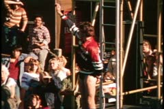 San Francisco, 1970's, Pier 39, high diving show, one diver waves to crowd - stock footage