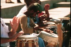 San Francisco, 1970's, three men playing conga drums, close up Stock Footage