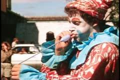 San Francisco, 1970's, clown making balloon sculptures, medium shot Stock Footage