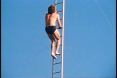 San Francisco, 1970's, Pier 39, high diving, diver climbs ladder, dive into pool - stock footage