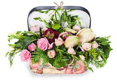 a colorful floral arrangement of roses and lilies in acardboard chest, isolat - stock photo