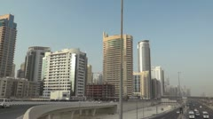 Sheikh zayed road and skyscrapers pan Stock Footage