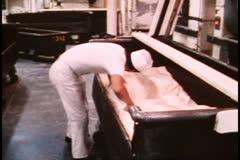 San Francisco, 1970's, Parisian sourdough bakery, man kneading tub of dough Stock Footage