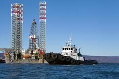 Jackup rig with tug boat in the Kachemak Bay, Alaska Stock Photos