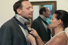 Wife knotting the necktie of her husband, helping him getting dressed Stock Footage
