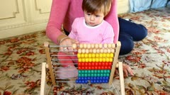 Mom and daughter playing with abacus Stock Footage