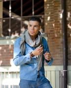 Handsome guy with scarf and jeans garment Stock Photos