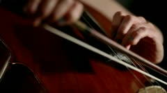 A cellist playing her instrument showing bowing and fingerboard technique Stock Footage