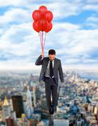 Businessman flying high Stock Photos