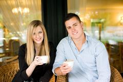 Stock Photo of cute young couple having coffee.