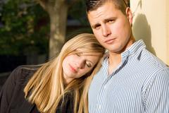 attractive young couple outdoors. - stock photo