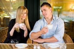 young couple at coffee shop. - stock photo