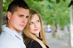 young couple outdoors - stock photo