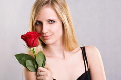 romantic blond with red rose. - stock photo