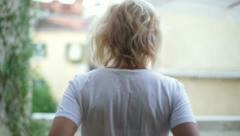 Woman goes to the balcony - stock footage