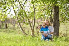Cute kid with his mom outdoors in nature. Stock Photos