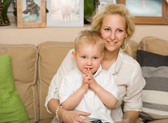 young fashionable mother with her son. - stock photo