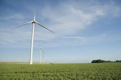 Wind turbines at the field Stock Photos