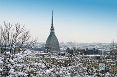 winter cityscape: mole antonelliana and turin, italy - stock photo