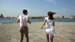 Boy and girl in Venice at the pier 3 - stock footage