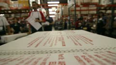 Boxes of votes picked off of a moving cart Stock Footage