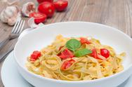 Stock Photo of pasta with garlic and tomatoes