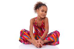 Stock Photo of cute young african asian girl seated on the floor