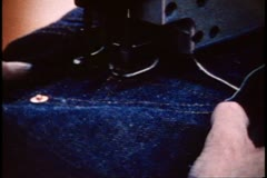San Francisco, 1970's, Rivet machine, putting rivets into blue jeans, close up Stock Footage