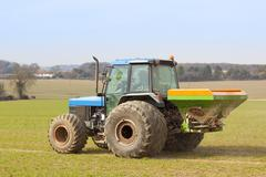 Spreading fertilizer Stock Photos