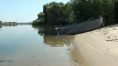Empty boat on the river bank 2 Stock Footage