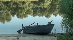 Empty boat at riverbank - stock footage