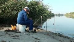 Angler at fishing place Stock Footage