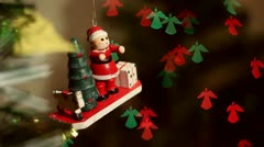 Christmas-tree decorations on angel-shaped background Stock Footage