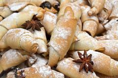 Freshly baked croissants with powdered sugar. Stock Photos