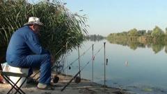 Fishing rods and angler smoking Stock Footage