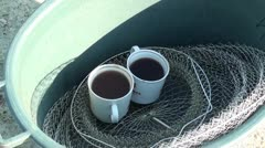 Fishing morning coffee zoom out Stock Footage