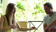 Happy, attractive couple eating breakfast together on the terrace, steadycam Stock Footage
