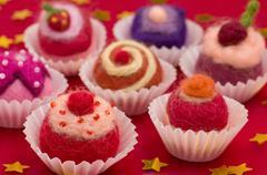 Christmassy assortment of colorful felt pralines Stock Photos