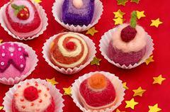 christmassy assortment of colorful felt pralines - stock photo