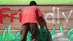 Mural painter writes n Stock Footage