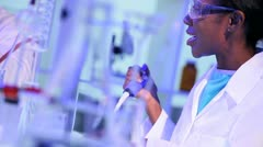Female Pharmaceutical Researcher in Laboratory Close Up Stock Footage