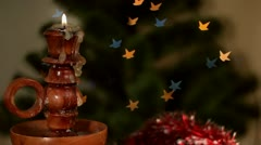 Christmas candle on starshaped background Stock Footage