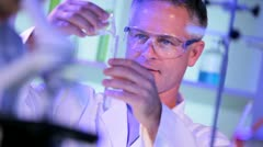 Caucasian Laboratory Assistant Conducting Medical Research Stock Footage