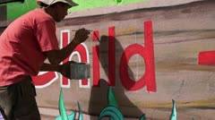 Mural painter writes i Stock Footage