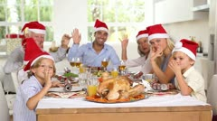 Family around the dinner table at christmas Stock Footage
