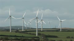 Wind Turbines and electric pylons in background Stock Footage