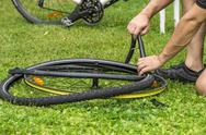 Stock Photo of repairing a flat bicycle tire
